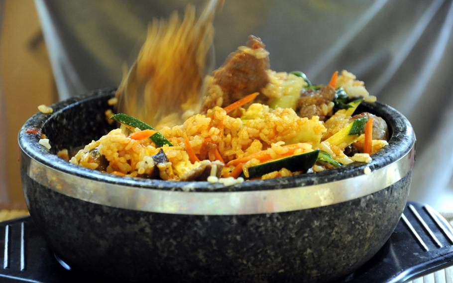 A dish of bibimbap, a traditional Korean, dish made with beef, rice, egg and vegetables, awaits a hungry reporter  at Eat Drink, Man Woman in Stuttgart, Germany, on Tuesday, June 29.