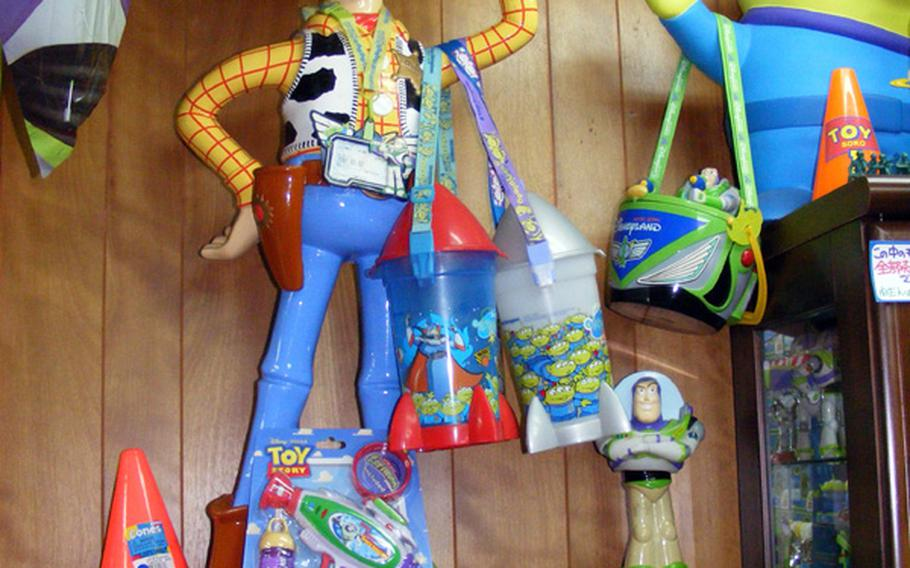 A giant plastic Woody, once used to greet theatergoers, is just one of some 500 separate 'Toy Story' collectibles Kentaro Ishihara sells at his 'Toy Story' shop on Okinawa.