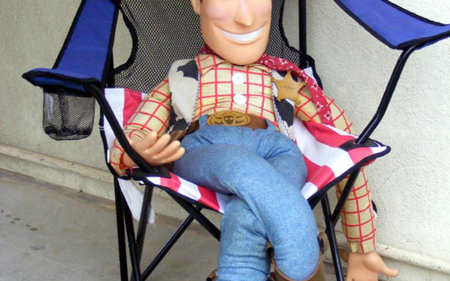 Woody, one of the main characters in the 'Toy Story' films played by Tom Hanks, greets customers to Kentaro Ishihara's Banana Flavors store, a 'Toy Story' collectibles shop in Ginowan, Okinawa.