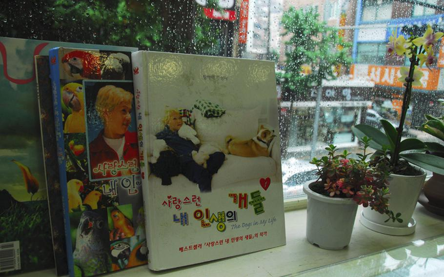 Books about Supreme Master Ching Hai and her conversations with her pets are on display beside a table in the Loving Hut, a vegan restaurant near Hannam Village in Seoul. The restaurant is part of an international chain affiliated with Hai.