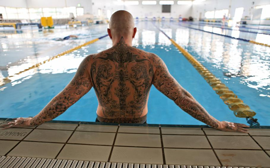 Mike Lilly, a military dependent at Yokota Air Base, Japan, shows off his tattoos. Lilly is unable to enter water parks in Japan because of his tattoos.