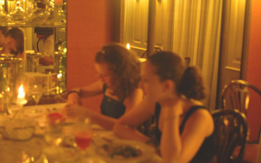 Clara and Colette Rogers, from left, find out that they like chanterelle cream sauce, roast saddle of lamb and candlelit dining. They got all three at the  Simplicissimus restaurant in Heidelberg, Germany.