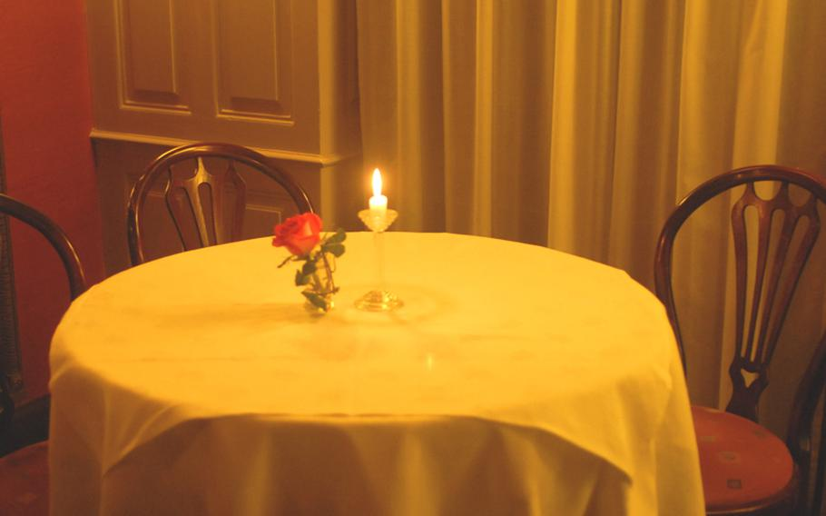 A rose and a candle decorate a table at Simplicissimus, which, translated from Latin, means 'very easy.'