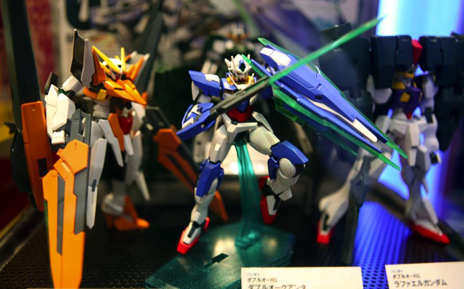 The High Grade Gundam Figures were among the toys at the International Tokyo Toy Show. These ready-to-make models include pre-colored pieces that easily snap together.