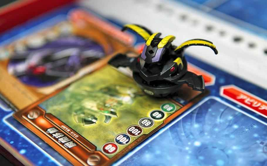 Bakugan Battle Brawlers is a card- and toy-based game that involves Bakugan, small spheres that pop open into powerful Bakugan monsters when rolled onto special metal gate cards. The object of the game is to capture three gate cards.