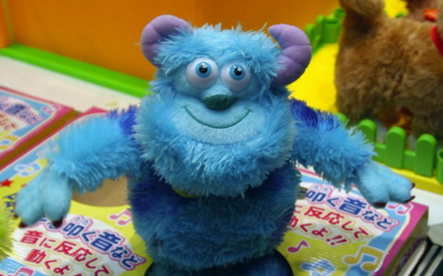 The Dancing Series Sulley doll, based on a character from the movie Monsters, Inc., wiggles its hips and dances to music or any kind of sound. The doll also plays three different songs of its own that it dances to.