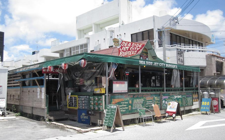 The walls of Sea Side Jet City Burgers display the restaurant's extensive menu. Located across from Araha Beach on Okinawa, it is a five-minute drive from Camp Foster.
