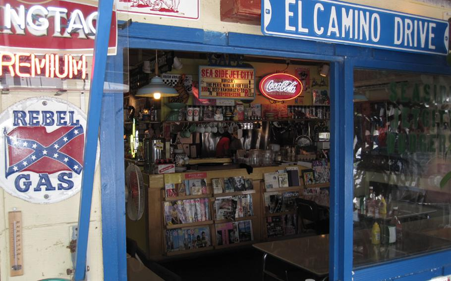 Vintage signs and other Americana memorabilia cover the walls and shelves of Sea Side Jet City Burgers on Okinawa.
