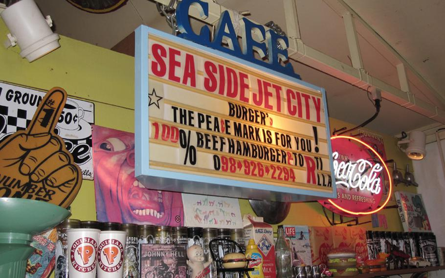 The shelves at Okinawa's Sea Side Jet City Burgers are crammed with American memorabilia.