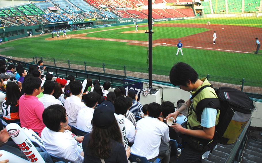 In this file photo from 2010, a vendor sells beer at Seoul's Jamsil Stadium during a South Korean professional baseball game between the Doosan Bears and the Samsung Lions.