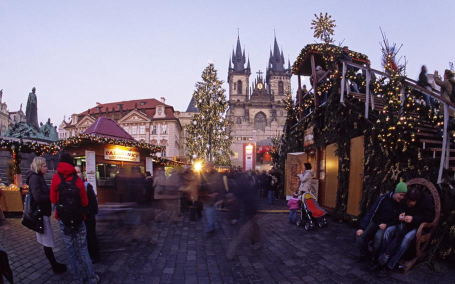 In Prague's Old Town Square, decorated booths sell handicrafts, Bohemian crystal, wooden toys and lots of food.