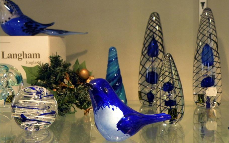 A handcrafted glass bird and other crystal products are for sale at Langham Glass. There are hundreds glass products available for purchase in the main display room.