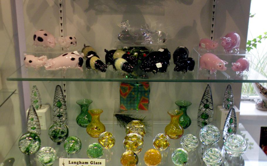 One of the many display cases at Langham Glass offers creations in many sizes. Langham Glass adds new pieces to its product line each year.