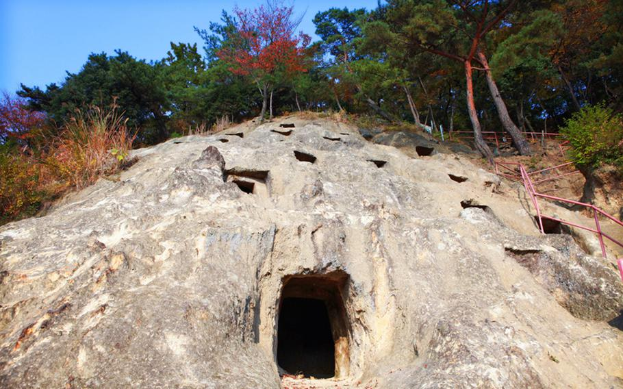 Visitors to the Yoshimi Hyakuana tombs can check out tombs like these, which used to hold dead bodies. The tombs have a history as both an ancient Japanese burial ground and as a World War II munitions factory.