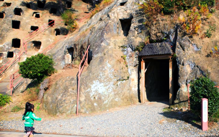 A little girl heads into the caves at the Yoshimi Hyakuana tombs.
