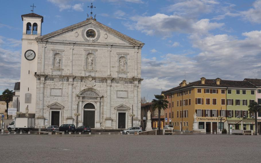 The cathedral of Palmanova, completed in 1636, faces the Piazza Grande, the town's main square. Six roads lead off from the gravel-strewn piazza. Three have gates that allow one-way entrance to the city.