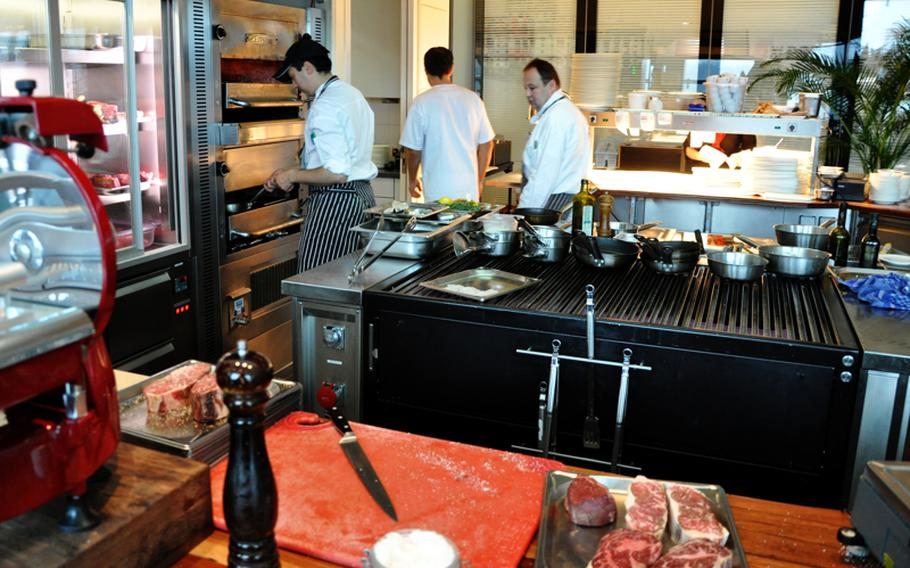 Cooks in the Christophorus steakhouse use a 1,500-degree-Fahrenheit oven to prepare high-priced dishes in the Porsche Museum in Stuttgart. The restaurant specializes in U.S. beef, but also serves venison, duck and fish.