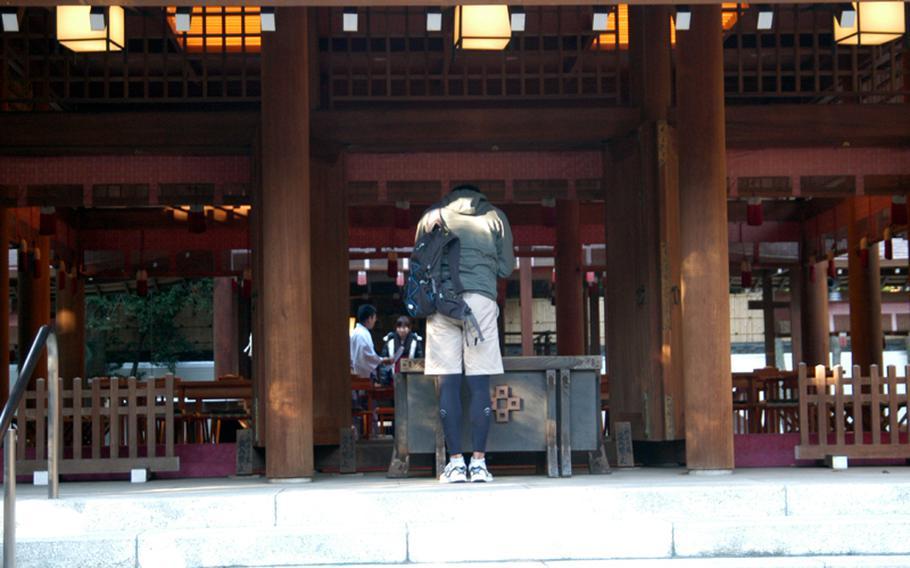A visitor prays at the altar in Nogi Jinja in Tokyo.