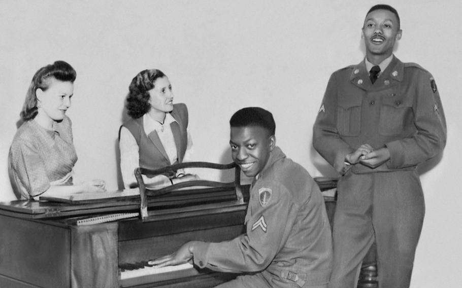 Irmgard Achatz from Kollbach, Germany, center, and one of her friends listen as her future husband, James W. Tanner of Philadelphia, sings while accompanied on piano by a fellow soldier. The life of black soldiers in Germany during and after World War II is the subject of a new book,  'A Breath of Freedom: The Civil Rights Struggle, African American GIs, and Germany.'