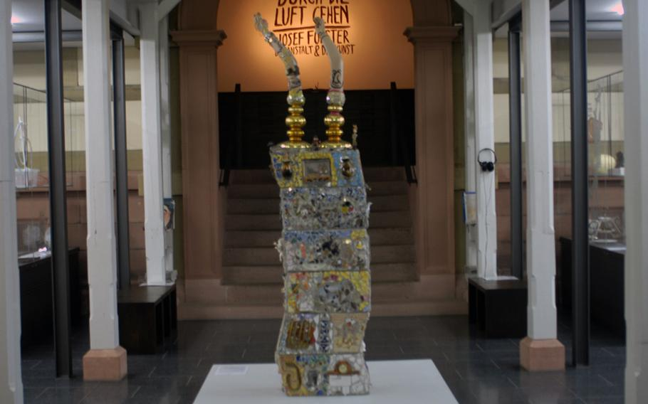 A mosaic-plastic sculpture called 2063 by Casim Wenzel stands at the entrance to the Prinzhorn Collection at the University of Heidelberg's psychiatry clinic.