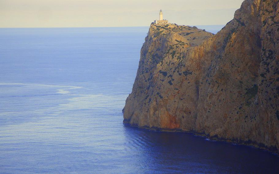In Majorca, lighthouses stand sentinel atop sheer cliffs, which drop straight down to the blue Mediterranean Sea.