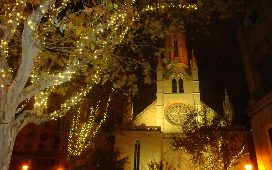 Lights hanging from trees illuminate the area around one of Palma de Majorca's churches. The city proved to be a good destination during the holiday off-season.