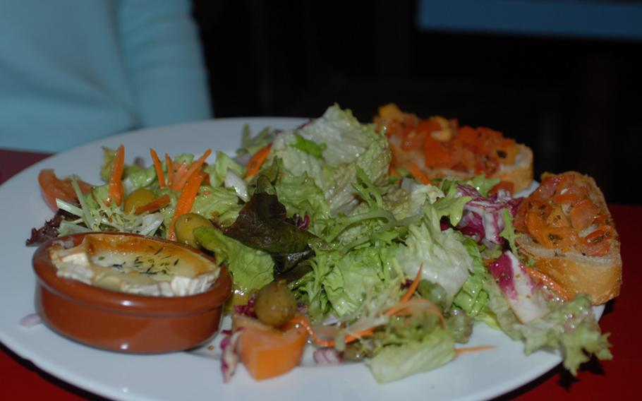 """A green salad with baked goat cheese was perfect. There is also a salad with duck breast, apples and spring onions, first prepared by """"three old aunts,"""" according to the menu."""
