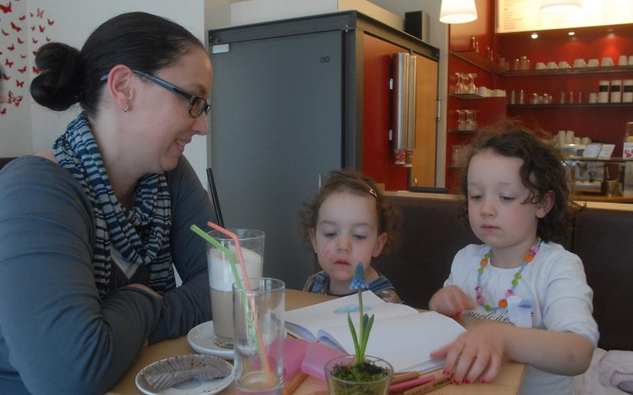 Michaela Schläfer and her two daughters, Paula, center, and Emma relax one recent afternoon at MilchundZucker, a coffee shop in downtown Kaiserslautern. The mom and her daughters frequent the coffee bar at least a couple of times a week. The shop draws a wide range of people, including a handful of Americans who come to enjoy the coffee and shop's free Internet access.