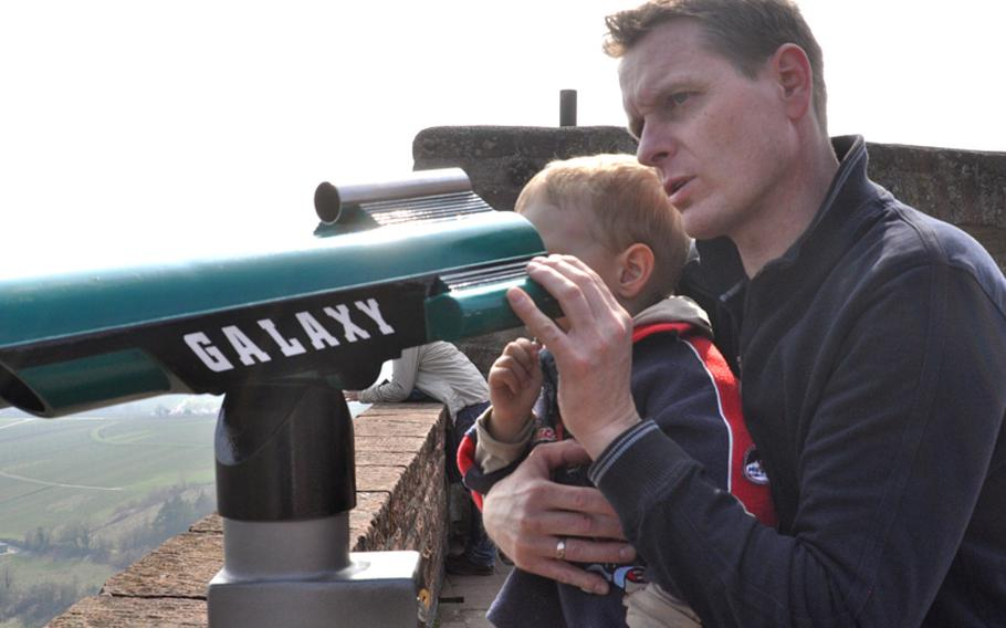 Horst Diemert and his 3-year-old son, Mika, peer through a telescope atop the Landeck Castle ruins. The castle serves as a playground for local children during the spring and summer months.  Seth Robbins/Stars and Stripes
