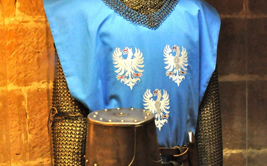 A suit of 13th-century armor on a mannequin inside the tiny museum in the Landeck Castle's main tower. The full suit of armor weighs about 35 kilograms, or 77 pounds.Seth Robbins/Stars and Stripes