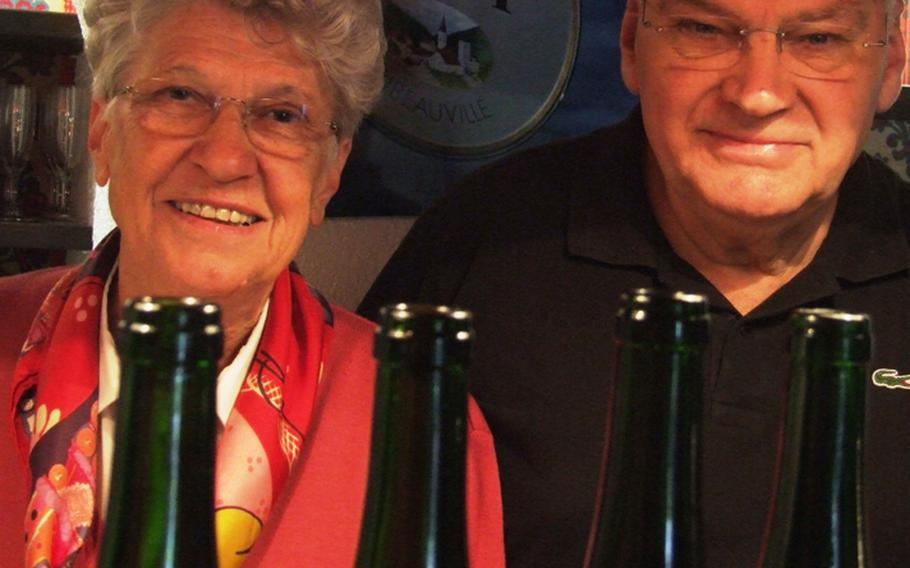 Simone and Pierre Sipp pose with some of their wares at the winery Louis Sipp, founded by Pierre's father, Louis, in Ribeauville, France. Simone says Alsatian white wines are fruitier than those made elsewhere in France.  She and her husband now run the winery.