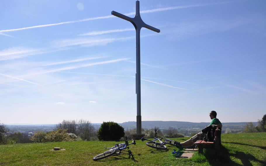 Marcus Gaylor, a native of New Zealand, takes a break from a recent mountain bike trip to view the city of Bamberg from the top of a nearby hill. There are many tourist sites in this part of Germany, but a lot of the smaller ones can be missed by drivers racing down the autobahn.