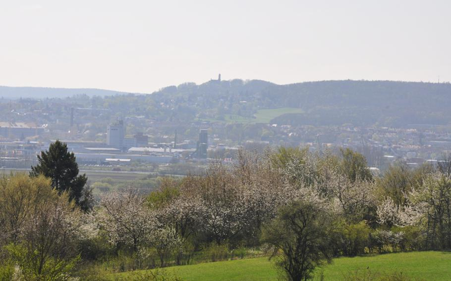 The city of Bamberg, topped by Altenburg castle, can  be seen from the Kreuzberg hillside outside the city. The hills are frequented by local bikers and easy to reach from the city.
