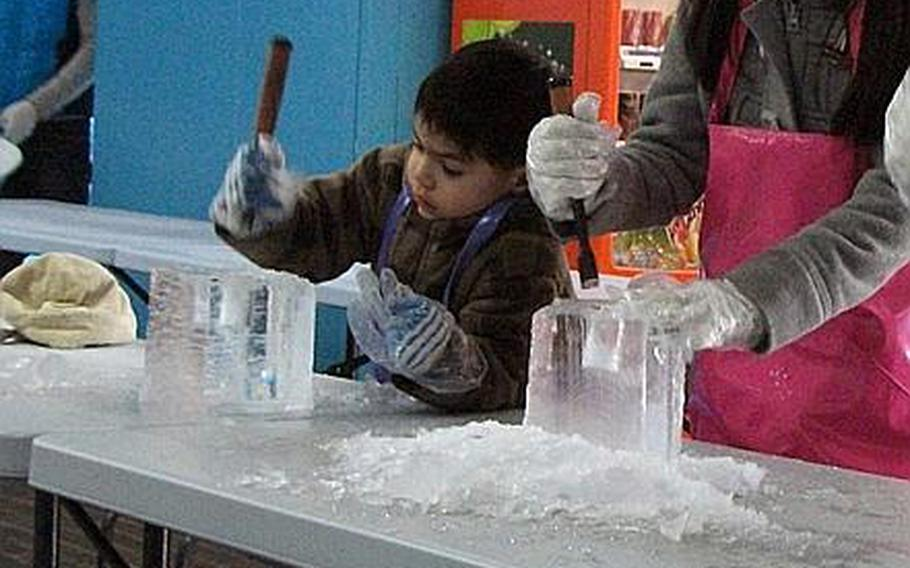 Natalya and Diego carve mugs out of blocks of ice during a trip to the Ice Gallery in Seoul.