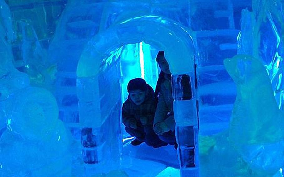 Natalya and Diego get inside an igloo during a visit to the Ice Gallery in downtown Seoul.