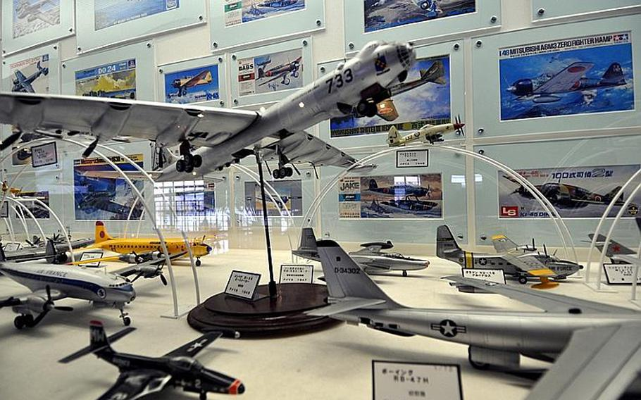 Hundreds of model airplanes line a long hallway on the second floor of the Misawa Aviation and Science Museum Aomori. The museum is a popular weekend destination.