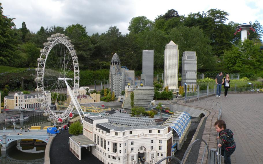 A child gets a close look at models of London's Waterloo Station and the London Eye at Miniland at Legoland Windsor amusement park. Miniland is home to nearly 40 million of the 55 million Lego blocks at the theme park.