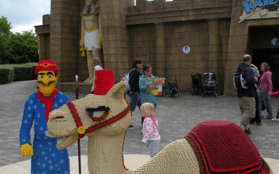 A Lego camel and its keeper appear in front of a large Egyptian statue -- also made out of Lego blocks -- at Legoland Windsor near London.