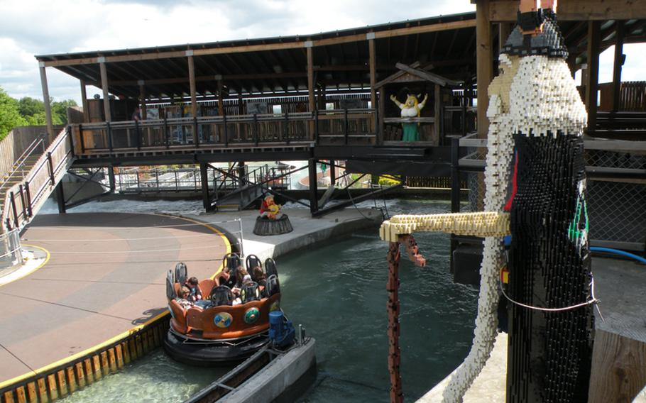 Life-size Lego Vikings peer down on park-goers at Legoland Windsor near London. The 150-acre theme park offers a multitude of rides and games.