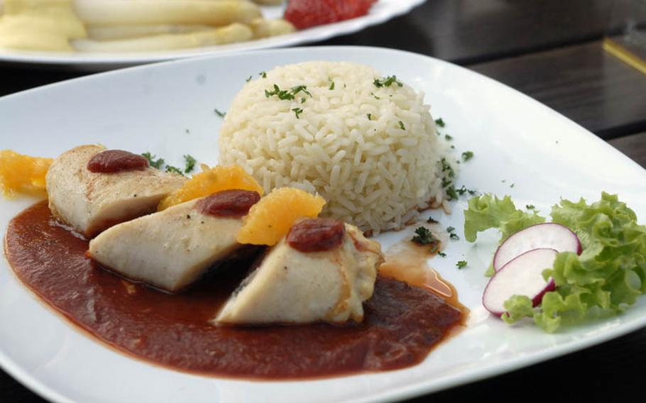 A chicken breast filled with ham and sage served with tomato sauce, rice and salad cost 13.40 euros at the Gasthaus Zum Engel in Wiesbaden, Germany.