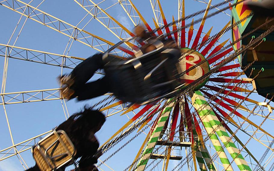 Amusement rides are among the Salzburger Dult's attractions.