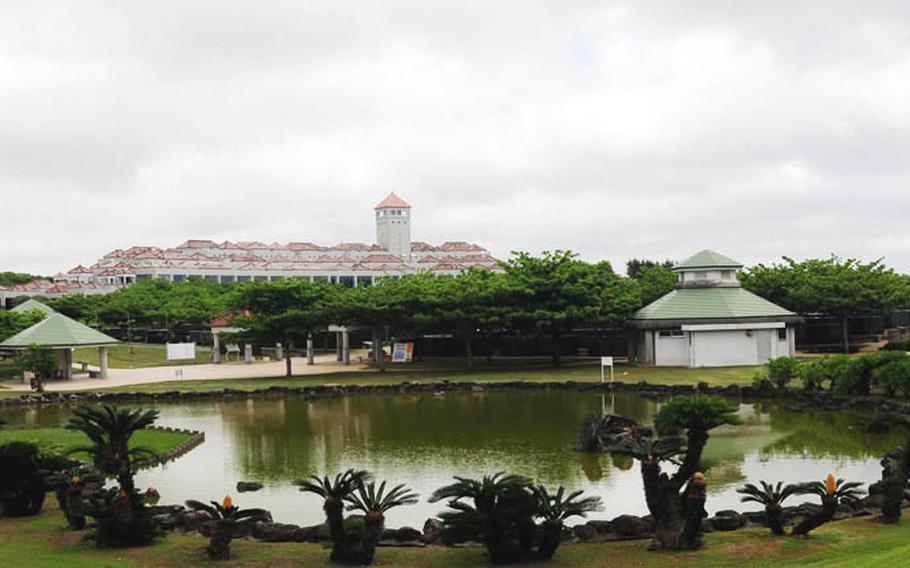 A large pond is located inside the park where turtles sun bake on rocks in the sun. The Okinawa Prefectural Peace Memorial Museum can be seen in the background.