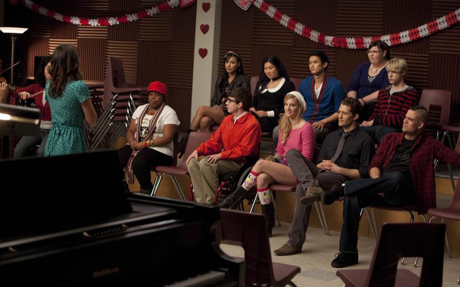 "Rachel (Lea Michelle), Mercedes (Amber Riley), Santana (Naya Rivera), Artie (Kevin McHale), Tina (Jenna Ushkowitz), Brittany (Heather Norris), Mike (Harry Shum, Jr.), Mr. Schuester (Matthew Morrison), Lauren (Ashley Fink), Sam (Chord Overstreet) and Puck (Mark Salling) in the ""Silly Love Songs"" episode of Glee."