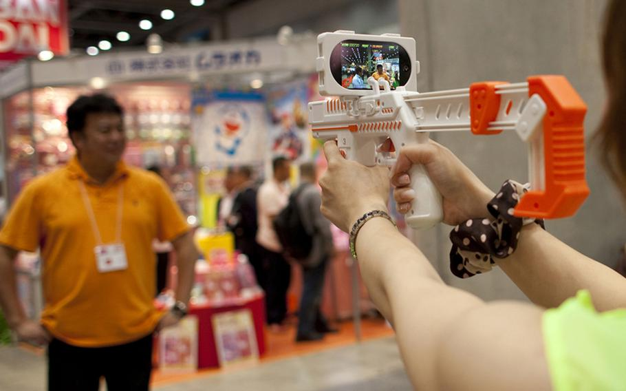This augmented reality toy gun — WIZ inc. appBlaster — uses your iPhone's or iPod Touch's ability to take video and turns it into a monster zapping game. Download the application, set your device on the gun, and play. Set to be released in September, it will cost about $35.