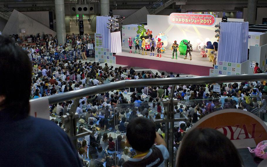 Thousands watch the Power Rangers perform at the Tokyo International Toy Show.