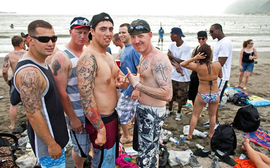 Sailors from the USS John S. McCain pose at Zushi Beach in 2011.