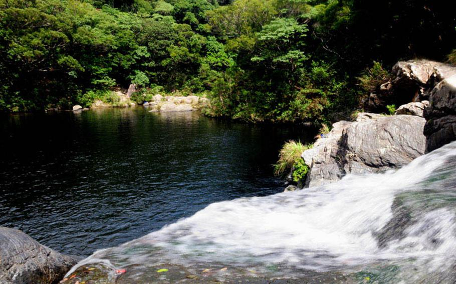 Water rushes down Aha Falls, Okinawa, to the large swimming hole at the base. The falls are about a 2 and 1/2 hour drive north of Kadena Air Base near the Northern Training Area.