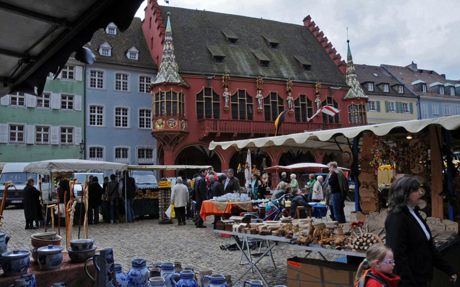 An antique and flea market is held on Saturdays in front of the decorative building that centuries ago served as a finance and customs center in Freiburg.