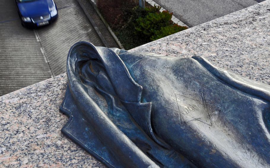 An unusual sculpture on a bridge near Freiburg's train station honors  the city's Jewish citizens who were deported by rail to Nazi death camps.