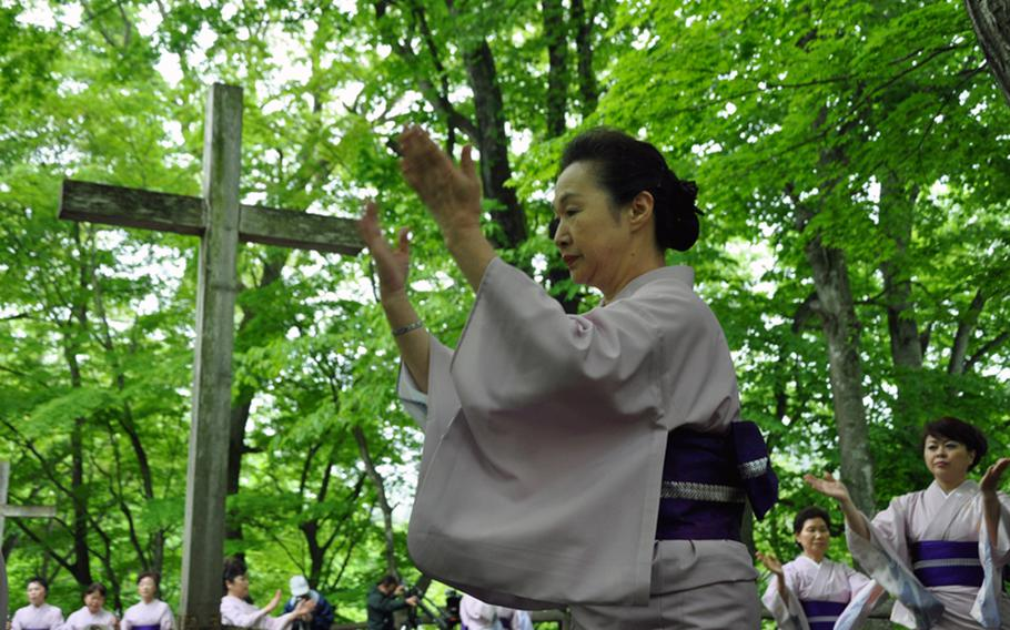 Women from Shingo, Japan, dance around what they call the Tomb of Christ, during a festival in late May.